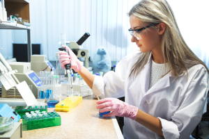 A woman in a lab uses chemical analysis to solve manufacturing issues