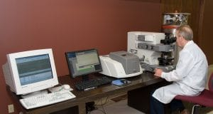 A scientist conducting FTIR analysis