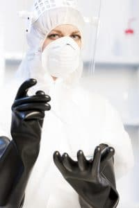 young woman wearing protective clothes conducting cleanliness testing