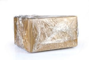 Box wrapped in plastic packaging material.