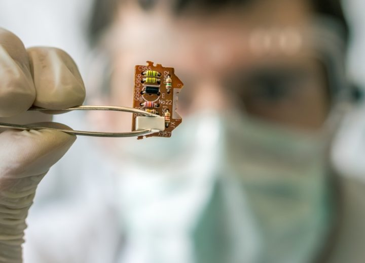 Research Scientist Working on New Electronic Chip